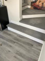 LVP Flooring w/ White Riser Stair and Carpet